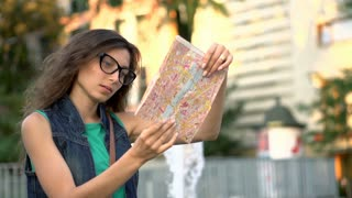 Tourist reading map in the city and checking way, steadycam shot, slow motion sh