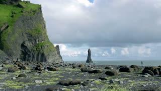 Tourists walking on Reynisfjara beach at south coast of Iceland at daytime