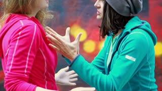 Two women having an argument, steadycam shot, slow motion shot