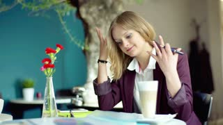 Unhappy businesswoman having problem while working on papers