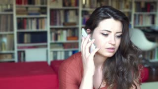 Unhappy woman talking on cellphone about some difficulties, steadycam shot