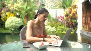 Attractive woman using notebook and having painful neckache, steadycam shot
