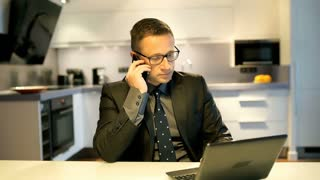 Bored businessman talking on cellphone and mimic someone