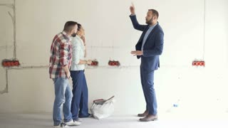 Couple discusses their new apartment with an architect, steadycam shot