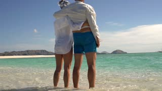 Couple spending time at the sea and feel free, steadycam shot, slow motion shot