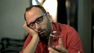Drunk man drinking red wine in the bar, steadycam shot