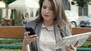 Elegant woman looking for the job and dials number on cellphone, steadycam shot