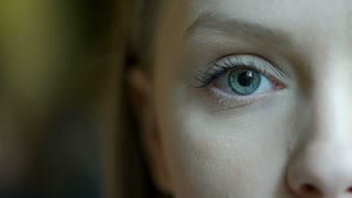 Girl with beautiful blue eyes looking to the camera, steadycam shot
