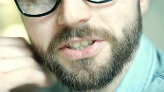 Handsome man with glasses talking to someone, close up, steadycam shot