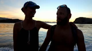 Happy couple floating on the boat during sunset, slow motion shot at 240fps, ste