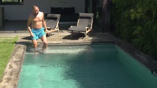 Man going to the swimming pool, steadycam shot, slow motion shot at 240fps
