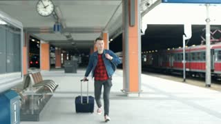 Man running for the train and looks irritated because he missed it, steadycam sh