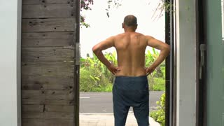Man standing in the door and admires the view, steadycam shot, slow motion shot