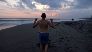 Man walking on the beach and feels free, slow motion shot at 240fps, steadycam s