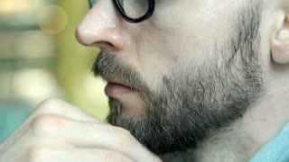 View of handsome man's face profile, close up, steadycam shot