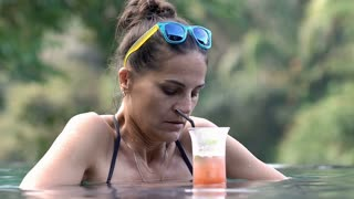 Woman looks worried while spending time in the swimming pool and thinking about