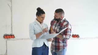 Woman signing papers connected with her new apartment and looks happy, steadycam