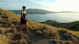 Woman walking on the mountain in a beautiful place, slow motion shot at 240fps,