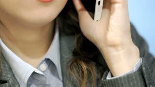 Worried businesswoman having a call on cellphone, steadycam shot