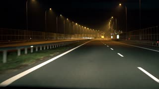 View of cars and signposts on the highway, steadycam shot