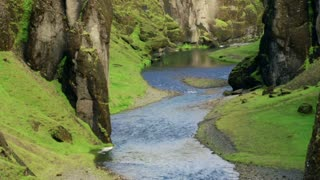 View of the magnificent Fjadrargljufur canyon and river running inside timelapse