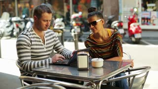 waitress bringing coffee for a couple sitting by the table
