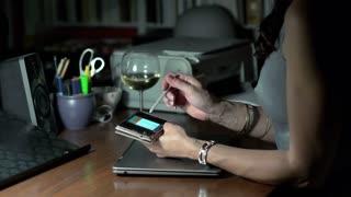 Woman browsing internet on smartphone, steadycam shot