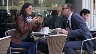 woman feeding her boyfriend outside the cafe, slow motion shot at 60fps