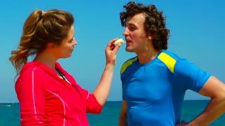 Woman feeding her boyfriend with banana, steadycam shot, slow motion shot