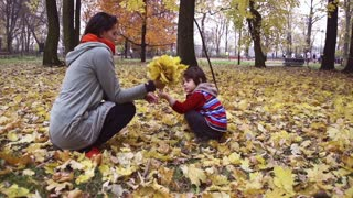 Woman holding bunch of leaves, steadycam shot, slow motion shot at 240fps