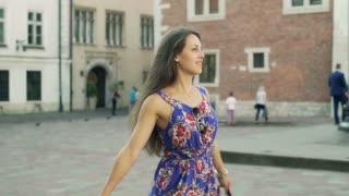 Woman holding shopping bags and going round, steadycam shot