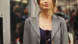 Woman looking at the camera in the subway, steadycam shot