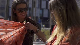 Woman smiling and putting on sarong, slow motion shot at 240fps, steadycam shot
