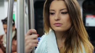Woman travelling by subway, steadycam shot.