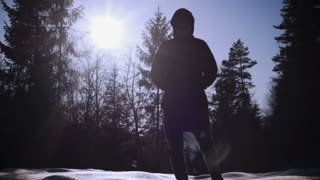Woman walking in sparkling snow, steadycam shot, slow motion shot at 240fps