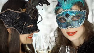 Women gossipping with each other and holding glasses with champagne, steadycam s