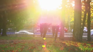 Women running in the sunlight, slow motion shot at 240fps