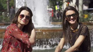Women smiling to the camera on the fountain, slow motion shot at 120fps