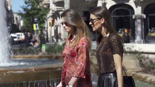 Women walking and talking in park, slow motion shot at 240fps, steadycam shot