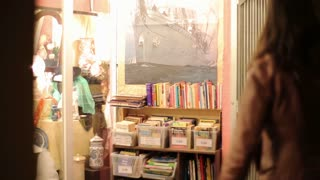 Young couple in bookstore at night, steadycam shot