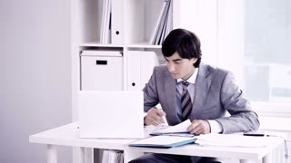 A young business man working in office. You can add your texts