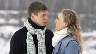 Amorous couple talking outside on a winter day