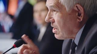 Assertive Senior Politician at Press Conference