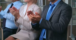Business people applauding excellent business training program in the office
