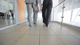Business team marching along the corridors of the office building