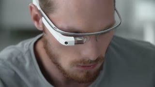 Close up of man concentrated on using google glass