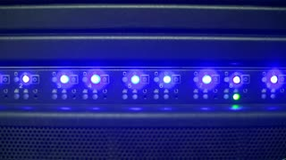 Close up of server panel illuminated with blue light of flash indicators