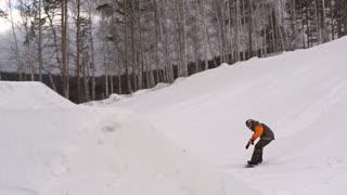 Cool snowboarder performing japan air grab