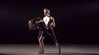 Dance partners demonstrating sensual dance pattern in slow motion
