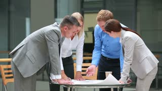 Enthusiastic company staff looking for the best financial solutions